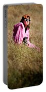 A Young Woman Sitting In A Field Portable Battery Charger