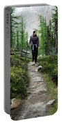 A Young Woman Walks Along An Sub-alpine Portable Battery Charger