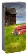 Abandoned Homestead House And Red Portable Battery Charger