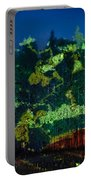 Abstract Colorful Light Projection On Trees Portable Battery Charger