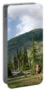 Adult Woman Hiking Through An Alpine Portable Battery Charger