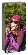 Adult Woman Laughing Out Loud While Portable Battery Charger