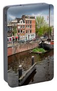 Amstel River Waterfront In Amsterdam Portable Battery Charger