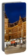 Amsterdam Central Station And Tram Stop At Night Portable Battery Charger