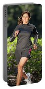 An Athletic Woman Trail Running Portable Battery Charger
