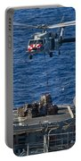 An Mh-60s Sea Hawk Delivers Supplies Portable Battery Charger