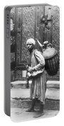 Arab Waterboy, C1900 Portable Battery Charger