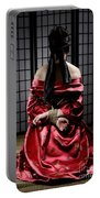 Asian Woman With Her Hands Tied Behind Her Back Portable Battery Charger