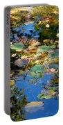 Autumn Water Lily Reflections  Portable Battery Charger