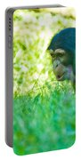 Baby Chimp In The Grass Portable Battery Charger