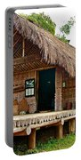 Bahnar Home With Extension As Family Grows At Museum Of Ethnology In Hanoi-vietnam  Portable Battery Charger