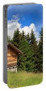 barn on Alpine pasture Portable Battery Charger