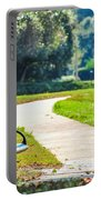 Bench In A Park With A Walkway Portable Battery Charger