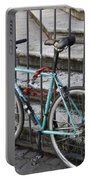 Bicycle Is Chained To A Fence Portable Battery Charger