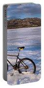 Bike On Frozen Lake Laberge Yukon Canada Portable Battery Charger