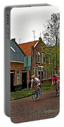 Bike Race On Orange Day In Enkhuizen-netherlands Portable Battery Charger