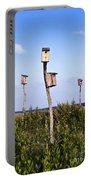 Birdhouses In Salt Marsh. Portable Battery Charger