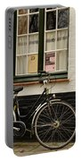 Black Cycle Rests On Window Sill Bruges Belgium Portable Battery Charger