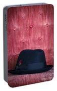 Black Hat On Red Velvet Chair Portable Battery Charger