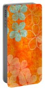 Blue Blossom On Orange Portable Battery Charger by Linda Woods
