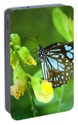 Blue Butterfly In The Green Garden Portable Battery Charger