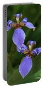 Blue Walking Iris Portable Battery Charger by Carol Groenen