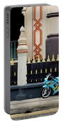 Blue Yellow Sporty Motorcycle Parked On Pavement Portable Battery Charger