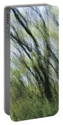 Blurred Trees Portable Battery Charger