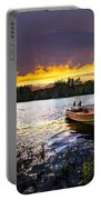 Boat On Lake At Sunset Portable Battery Charger