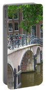 Bridge Over Canal With Bicycles  In Amsterdam Portable Battery Charger