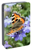 Butterfly On Blue Flower Portable Battery Charger