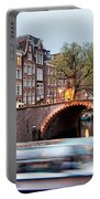 Canal Bridge And Boat Tour In Amsterdam At Evening Portable Battery Charger
