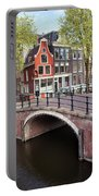 Canal Bridge And Houses In Amsterdam Portable Battery Charger