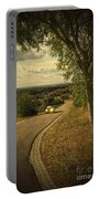 Car On Road Portable Battery Charger by Carlos Caetano