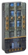 Carbide And Carbon Building Portable Battery Charger by Adam Romanowicz