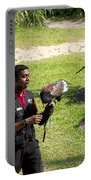 Cartoon - A Trainer And A Large Bird Of Prey At A Show Inside The Jurong Bird Park Portable Battery Charger