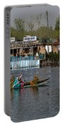 Cartoon - Ladies On 2 Wooden Boats On The Dal Lake With The Background Of Houseboats Portable Battery Charger