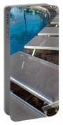 Chairs Around Hotel Pool Portable Battery Charger by Brandon Bourdages