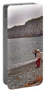 Children Throwing Capelin Back Into The Ocean At Middle Cove-nl Portable Battery Charger