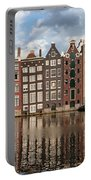City Of Amsterdam At Sunset In Netherlands Portable Battery Charger