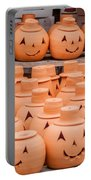 Clay Pumpkins Standing Happy Near The Wood Fence Portable Battery Charger