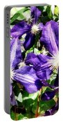 Clematis On A Stone Wall Portable Battery Charger