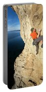 Climber Reaches For Hand Hold Portable Battery Charger