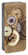Clockwork Mechanism On The Sand Portable Battery Charger