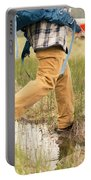 Close-up Of A Male Hiker Portable Battery Charger