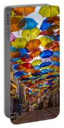 Colorful Floating Umbrellas Portable Battery Charger by Marco Oliveira