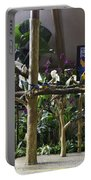 Colorful Macaws And Other Small Birds On Trees At An Exhibit Portable Battery Charger