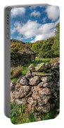 Cottage Ruin Portable Battery Charger by Adrian Evans