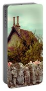 Cottage Seen Over A Wall Portable Battery Charger