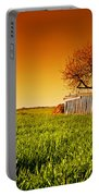 Countryside Orchard Landscape At Sunset. Spring Time Portable Battery Charger